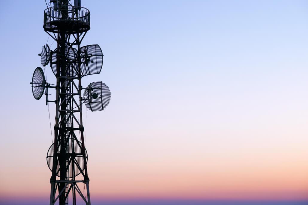 Telecommunication Tower Antenna At Sunset Sky  | QXC Communications